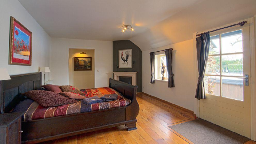 De aparte slaapkamer van de Wellness Suite